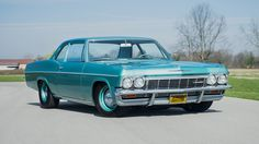 1965 Chevrolet Bel Air...I'm in lust...look at that stance...steelies and dog dishes, post car...mmmmmm...