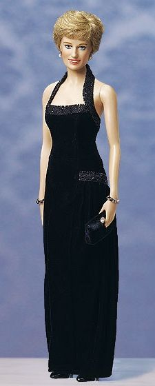 Princess Diana - Black Velvet Gown Vinyl Portrait Doll by Franklin Mint Meticulously crafted in lifelike, poseable vinyl, this breathtaking portrait doll captures all the grace and charm of the beloved People's Princess. Every feature is painted delicately by hand, from those sparkling blue eyes to the gentle blush on her creamy white cheeks. Her stunning gown glitters with a galaxy of beads set against an expanse of black velvet.