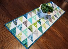 Modern Quilted Table Runner, Half Square Triangle Runner in Blues, Green and White, Quiltsy Handmade Table Runner Quilt by QuiltSewPieceful on Etsy Handmade Table, Handmade Items, Handmade Decorations, Table Decorations, Free Spirit Fabrics, Tablerunners, Quilted Table Runners, Custom Quilts, True Colors