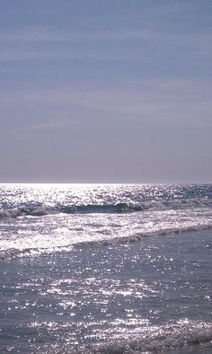The ocean looks like a million sparkling diamonds. It's spring break and I'm not there because.....????