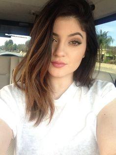medium length brown hair with light highlights