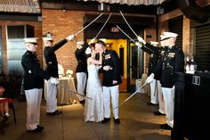 Sword arch coming into reception as our grand entrance if doing it after ceremony is complicated