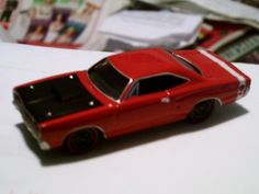 1969 Dodge Super Bee (the musclecar on a budget - a bare bones Coronet with a big engine, fibreglass hood and SuperBee stripe, the black steel wheels didn't even come with dog dish caps) made by Johnny Lightning