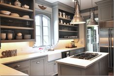 Benjamin Moore Fieldstone grey moldings and cabinets, white walls....cool