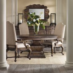 Classical design motifs from ancient Europe such as the urn shape used on the round dining table base give a historical resonance to Rhapsody.