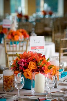 aqua blue vases and coral flowers low centerpiece