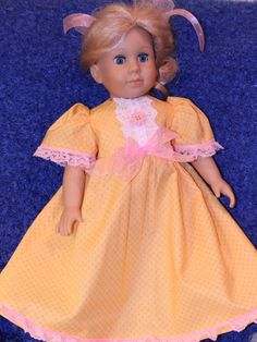This listing is for the very pretty Yellow dress in the first two pictures. It has puffy sleeves with delicate pink lace around them. It also has an empire waist with a pale pink ribbon bow. The yoke of the dress has a very pretty white lace accent with pink ribbon and a pretty pink flower button. The bottom of this pretty gown has the same pink lace that was used for the sleeves. The back of the dress fastens with Velcro strips to make this easy for your child to dress or undress her doll…