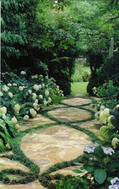 Crab Orchard stone laced with dwarf mondo grass solved a shady, mucky problem in Sharon McHale's Atlanta garden. Would look grat on a driveway