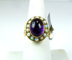 Opal and amethyst poison ring