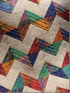 I may have to take this Craftsy class to learn how to do those swirls!  Isn't this a great quilt??