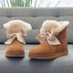 A tonal satin bow adds to the charm of a cozy boot lined and.- A tonal satin bow adds to the charm of a cozy boot lined and accented with genuine shearling - boots uggs Ugg Boots Outfit, Ugg Style Boots, Shearling Boots, Leather Boots, Cute Uggs, Uggs On Sale, Ugg Sale, Uggs With Bows, Doc Martens Boots