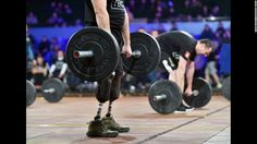 """Competitors lift weights in the """"Games of the Heroes"""" final competition during the CrossFit Games in Kiev, Ukraine, on Saturday. Some 15 Ukrainian servicemen who became disabled during the fighting with pro-Russian separatists took part in the competition."""