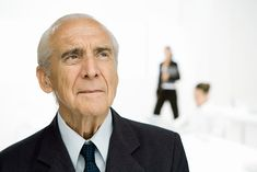 Senior businessman looking up, portrait