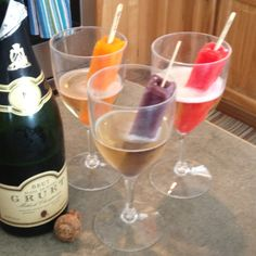 Champagne Popsicles....this would be a good idea with anything! 7Up and orange creamcicles! Yum!!!!