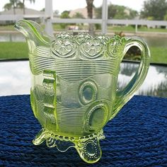 *GREENTOWN GLASS CO. ~ introduced the Dewey pattern in 1898 in honor of Admiral Dewey, hero of the Spanish American War. This was one of the larger patterns produced by Indiana Tumbler & Goblets in golden Agate. The pattern reached its height of popularity in 1899, Canary Yellow Creamer.