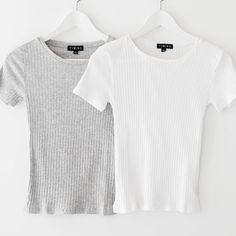"""Basic round neck crop top with short sleeves and a slightly cropped fit. Made with lightweight and stretch ribbed knit material. Size small measures approx. 20.5"""" in length. Available in white or grey"""