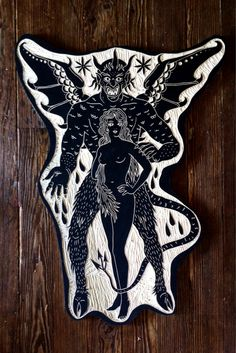 Carved wood tattoo by Bryn Perrot