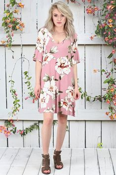 Short sleeve, loose fitting, swing style dress with a gorgeous magnolia floral blossoms print on it. Mauve in color. Ties in the back with keyhole.