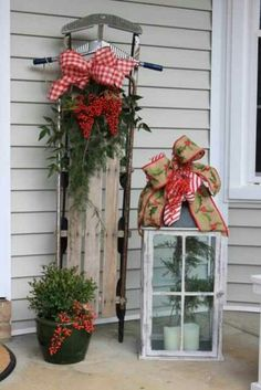 Old window ideas - a giant lantern!  I LOVE this!!And the sleigh would look great out front between the two garage doors!