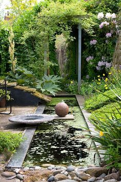Delightful Rectangular Pond With Stoneware Pots By Gordon Cooke