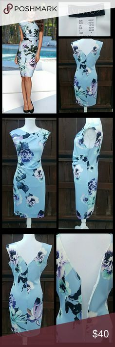 """Venus dress NWOT...Gorgeous floral sheath dress from Venus. So soft and stretchy. Features back zipper and back v-neck, 3 small ruffles on the chest and waist.Outseam approx 38-1/2"""" Pit to-pit approx 19-1/2"""". VENUS Dresses Midi"""