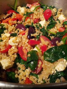 Pearl Couscous with spinach, grape tomatoes, red bell peppers, kalamata olives, chicken breast, and feta.