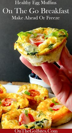 Protein rich, portable healthy egg muffins are a great on the go breakfast.  A twist on the traditional egg casserole includes healthy ingredients like spinach and yogurt and comfort food like sausage and cheese. A little bit for everyone! Great for parties or brunch because the breakfast casserole can be made ahead.The mini muffins make an elegant appetizer. Gluten free, keto and low carb options. Portable on the go suggestions. OnTheGoBites.Com