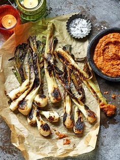 This recipe for tender spring onions with charred romesco makes a great vegan alternative for the BBQ.
