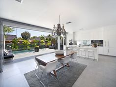 Casual dining room idea with polished concrete & floor-to-ceiling windows - Dining Room Photo 627851