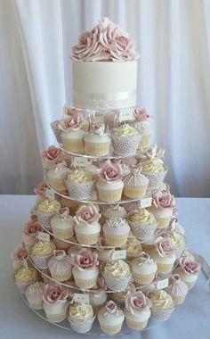 Beautiful cupcake tower with wedding cake