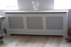 RADIATOR COVERS- Learn how to fit a Radiator Cabinet - it's a great way to hide an ugly radiator - with the help of this DIY Heating Guide. Grey Radiator Covers, Diy Radiator Cover, Baseboard Heater Covers, Old Radiators, Built In Furniture, Front Rooms, Cabinet Design, Interior Design Living Room, Home Deco