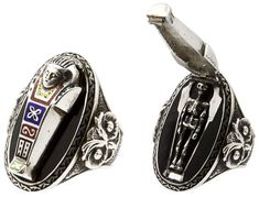 This sterling silver and enamel Egyptian Revival ring, circa 1920, has a coffin that opens to reveal a tiny skeleton. (The Hairpin, via Past...