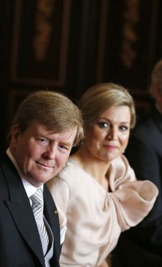 Crown Prince Willem-Alexander and his wife Crown Princess Maxima attend the meeting at the Royal Palace in Amsterdam April 30, 2013, before Queen Beatrixs abdication ceremony. The Netherlands is celebrating Queens Day on Tuesday, which also marks the abdication of Queen Beatrix and the investiture of her eldest son Willem-Alexander.