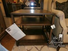 Ethan Allen Highland end table with criss cross sides and tiered openings. Measures 28x28x26. Retails currently for $823.