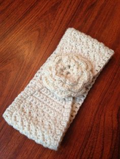 Teen, women, and children cream crochet winter headband with flower and button closure