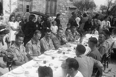 New Zealand soldiers enjoy lunch in Galatas during a post-war visit to Crete, 29 September Battle Of Crete, Lieutenant General, War Photography, Prisoners Of War, Lest We Forget, Place Names, World War One, German Army, Military History