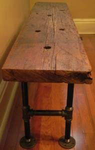 barnboard bench with conduit legs More