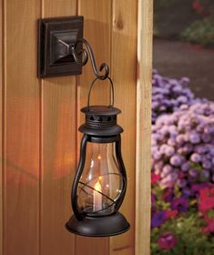 This Old-Fashioned Solar Lantern illuminates any outdoor living area. The metal, antique-styled lantern looks great on a patio table. It has a wire handle for suspending on the included wall-mounting bracket. Feature it on a tree branch or your own sheph