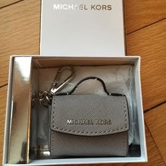 NEWMichael Kors Ava Key Fob NEW Michael Kors Ava Key Fob. Comes with gift box. The color is pearl grey for this listing. The last 2 pictures are silver and just for show. no tradeno Paypalno holds no lowball offers✅10% off bundles Michael Kors Accessories Key & Card Holders