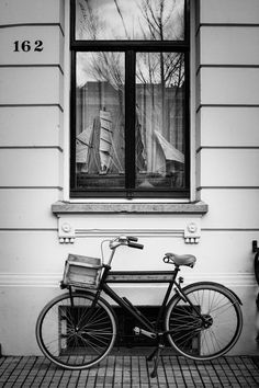 """Feature a B&W photograph on your gallery wall surrounded by paintings and drawings.  """"Bicycle"""" by Michael Grimm http://www.purephoto.com/150361mg/art/84582#.VNJLMmR4r0c"""