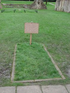 Marked burial place of King Arthur and Queen Guinevere at Glastonbury Abbey ruins, Glastonbury, Somerset, England. Around 1190, Avalon became associated with Glastonbury, when monks at the Glastonbury Abbey claimed to have discovered the bones of Arthur and his Queen.