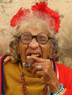 Old lady smoking a cigar, Vinales, Cuba