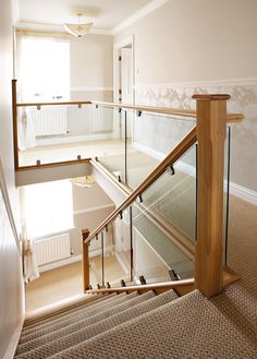 There's an entire project description around this staircase! Click through to see. Oak and Glass Staircases - Neville Johnson Staircases