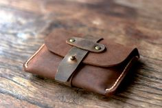 The Treasure Chest Credit Card Wallet is a JooJoobs original design. This hand-stitched gem is made from soft, durable oiled leather. Two interior sleeves hold 8-10 credit cards.