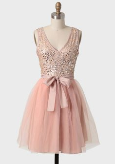 Majestic Night Sequin Dress 54.99 at shopruche.com. Dazzling with gold and silver sequins, this peachy pink dress features a voluminous tulle overlay skirt and a V-cut neckline and back. Finished with a removable self-tie taffeta ribbon and a hidden side zipper closure. Fully lined.36