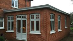 Residence 9 - Red brick orangery with Painswick Residence 9 windows by Fenland Windows