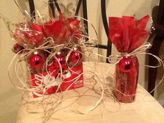"I decorated each coke bottle with decorative red  gold tissue  cellophane. I tied it up with paper raffia ribbon  attached a small ornament. I used these as centerpieces for my sister's surprise 40th birthday party. She's a Christmas eve baby, so ""Christmas"" was the theme."