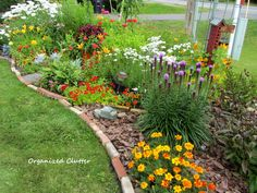 What a wonderfully mixed border - the use of the bricks, rocks and mulch add to the unstructured look. Garden Junk, Lawn And Garden, Amazing Gardens, Beautiful Gardens, Mixed Border, Garden Oasis, Garden Edging, Garden Inspiration, Garden Ideas
