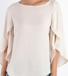 - Scoop Neckline - Butterfly Sleeves - Loose Fitting                                                                                                                                                                                 More