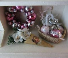how to: Christmas roses cornucopia Love the ornaments in the basket, they would be great for a mini valentine tree!